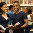 Group of african american university students in library — Stock Photo #20130597