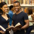 Group of african american university students in library — Stock Photo