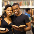 Happy african american university couple in library — Stock Photo