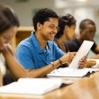 Happy male african american college student using tablet computer — Stock Photo