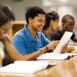Stock Photo: Happy male african american college student using tablet computer