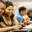African american college students using laptop computer — Stock Photo #20130729