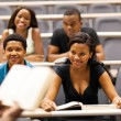College professor lecturing group of african students in classroom — Stock Photo