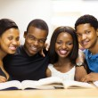 Group of african american college students in library — Stock Photo