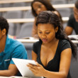 Group of african college students in lecturing hall — Stock Photo