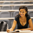 Female african american college student sitting in lecture hall — Stock Photo