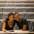 Happy african american college couple in lecture room — Stock Photo
