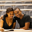 African american college couple in lecture hall — Stock Photo