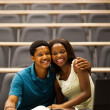 African college girlfriend and boyfriend in lecture room — Stock Photo