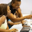 Group of african american college students in computer room — Stock Photo #20130983