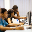 African american college students in computer room — Stockfoto