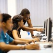 African american college students in computer room - Stock Photo