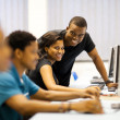 Group of african american college students in computer room — Stock Photo #20131021
