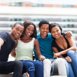 Group of happy african college students sitting outdoors — Stock Photo #20131029