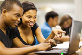 African american college students using laptop computer — Stock Photo