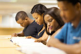 Group of african college students reading in library — Stock Photo