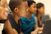 Group of african american college students in lecture room — Stock Photo