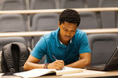 Male african college student in lecture room — Stock Photo