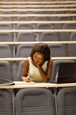 Female african american university student sitting in lecture room — Stock Photo
