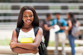Happy african college girl outdoors on modern campus — Stock Photo