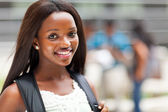 Pretty female african american high school student on campus — Stock Photo