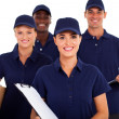 Foto Stock: Group of delivery service staff half length on white