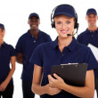 Foto Stock: IT service call center operator with headphones and team
