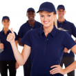 Technical service woman thumb up with team in background — Stock Photo #20188883