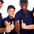 Group of service staff thumbs up on white — Stock Photo