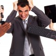 Stock Photo: Frustrated businessmaround by multiple office tools