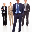 Foto Stock: Handsome african businessman and team full length on white