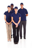Group of delivery service staff full length portrait on white — Stock Photo