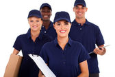 Group of delivery service staff half length on white — Stock Photo