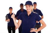 Teknik servis kadın başparmak ile takım arka planda — Stok fotoğraf
