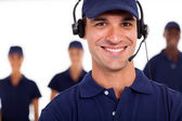 Professional technician with headphones on the call — Stock Photo