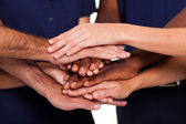 Multiracial hands together to form teamwork — Stock Photo