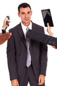 Tired male office worker with multiple gadgets around him — Stock Photo