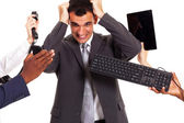 Frustrated businessman around by multiple office tools — 图库照片