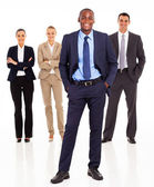 Handsome african businessman and team full length on white — Stock Photo