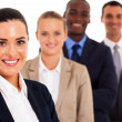 Stock Photo: Pretty female corporate worker and team on white