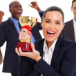Excited business team winning a trophy — Stok fotoğraf