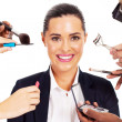 Pretty businesswoman with makeup tools around her - Zdjęcie stockowe