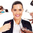 Pretty businesswoman with makeup tools around her - Stockfoto
