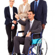 Stock Photo: Handicapped business leader on wheelchair pointing