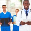 Handsome african american medical doctor and team — Stock Photo