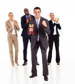 Smart businessman and team winning a trophy — Stock Photo