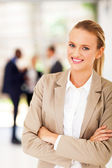 Pretty young office worker portrait in modern office — Stock Photo