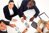 Overhead view of group of business having meeting together — Stock Photo