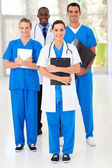 Group of medical workers full length portrait in hospital — Stok fotoğraf