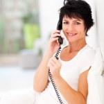 Woman talking on landline phone — Stock Photo